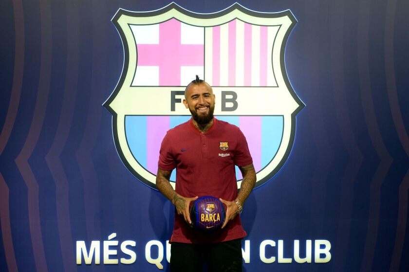 Former player of Bayern Munich football club, Arturo Vidal, poses at his new team's headquarters on August 5, 2018, one day after FC Barcelona announced an agreement with Bayern Munich to sign Chilean midfielder in a deal reportedly worth 30 million euros ($35 million).