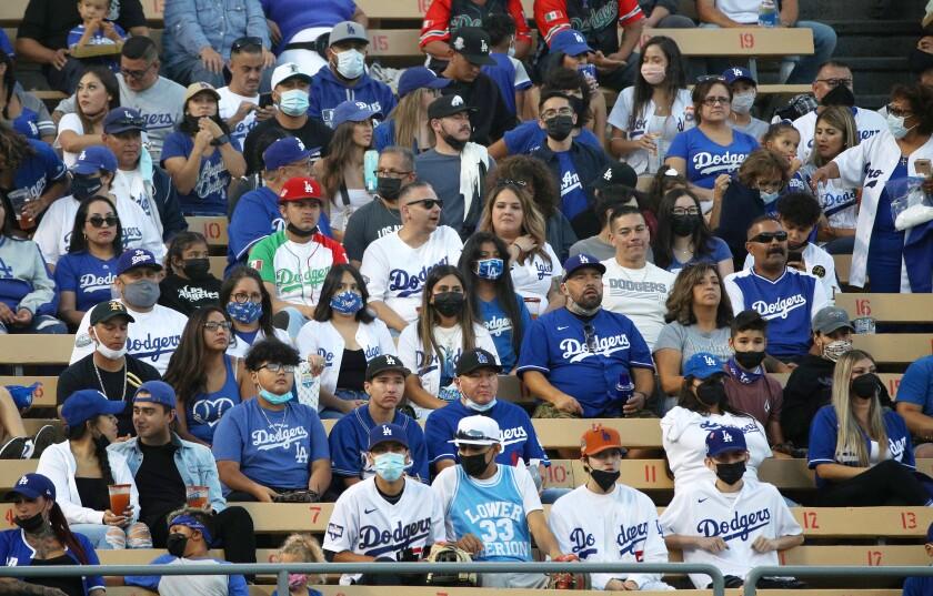 Fans sit in the bleachers at Dodger Stadium.
