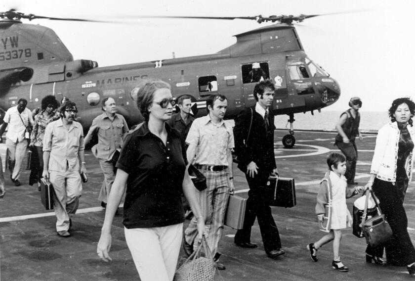 In this April 29, 1975, file photo, American citizens arrive on the USS Blue Ridge after being evacuated out of Saigon.