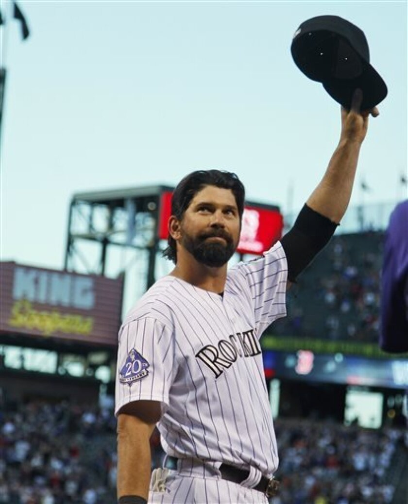 Colorado Rockies first baseman Todd Helton tips his cap while being honored before his final home baseball game, against the Boston Red Sox, in Denver on Wednesday, Sept. 25, 2013. Helton is retiring at season's end after 17 years with the Rockies. (AP Photo/David Zalubowski)