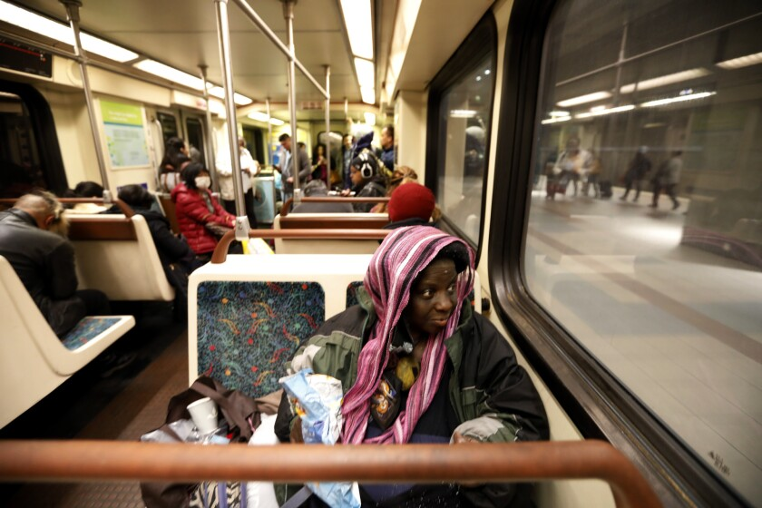 LOS ANGELES, CA MARCH 27, 2018: Melissa Crawford, 54, rides on the Red Line early in the morning i