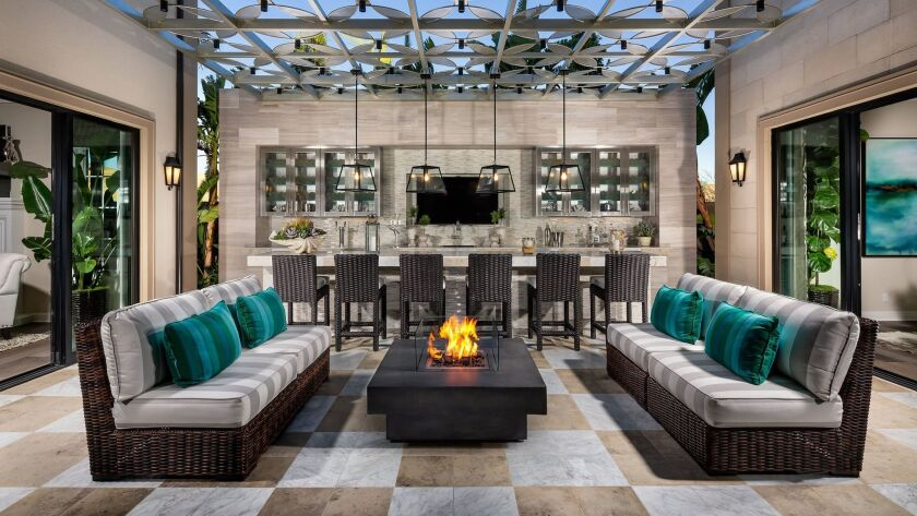 Premium lighting, a TV and a built-in fire pit help create a luxury outdoor living space.