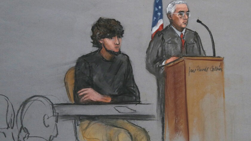 In this Jan. 5, 2015, courtroom sketch, Boston Marathon bombing suspect Dzhokhar Tsarnaev is depicted beside U.S. District Judge George O'Toole Jr. as the jurist addresses potential jurors at the federal courthouse in Boston.