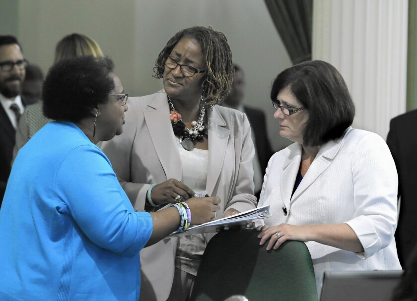 Assemblywoman Shirley Weber (D-San Diego), left, discusses legislation with Sen. Holly Mitchell (D-Los Angeles), center, and Assemblywoman Susan Bonilla (D-Concord).