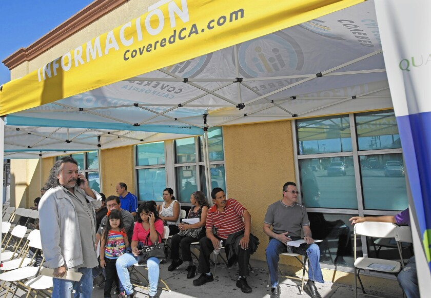 People wait to sign up for Obamacare at AltMed Health Services in Los Angeles in February.