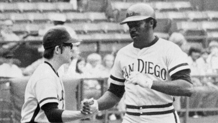Padres first baseman Nate Colbert is congratulated by a batboy after hitting one of his five home runs against the Braves during a doubleheader in 1972.