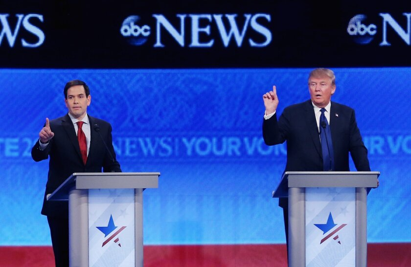Sen. Marco Rubio of Florida, left, and Donald Trump try to get a word in at St. Anselm College in Manchester, N.H.