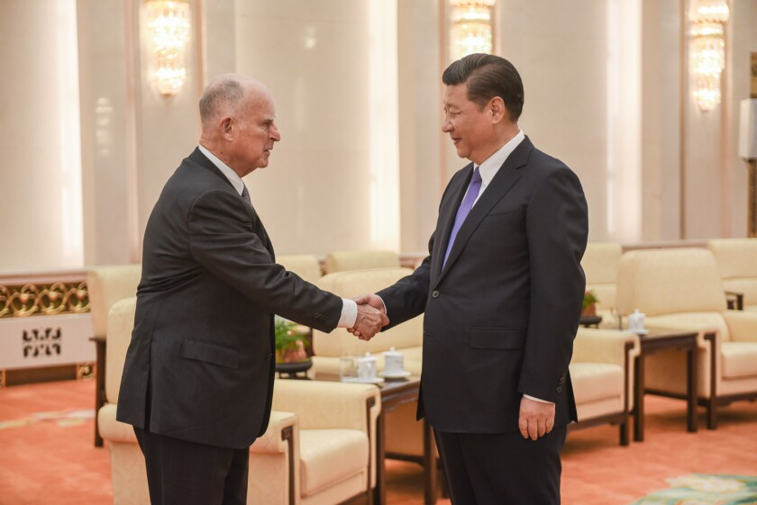 Gov. Jerry Brown and President Xi Jinping meet earlier this month in Beijing.