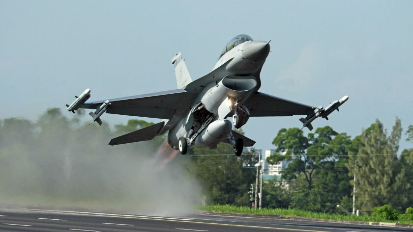 FILE - In this Sept. 16, 2014, file photo, a Taiwan Air Force F-16 fighter jet takes off from a clos