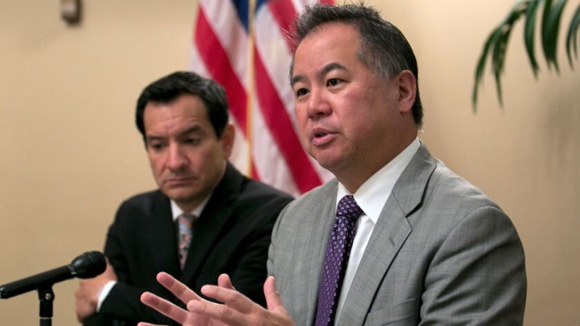 Assemblyman Phil Ting (D-San Francisco), right, has written a bill that would make some police body camera footage public.