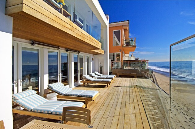 By David A. Keeps Interior designer Trip Haenisch, who has done homes for Courteney Cox, Christina Aguilera and Cher, recently completed a contemporary architectural home in Malibu that took its cues from the surrounding sand, surf, sky and sunlight. On the deck, a teak table and seating are from Summit Furniture, and the striped outdoor fabric on cushions is by Perennials. To see how Haenisch brought the outdoor elements inside, keep reading ...