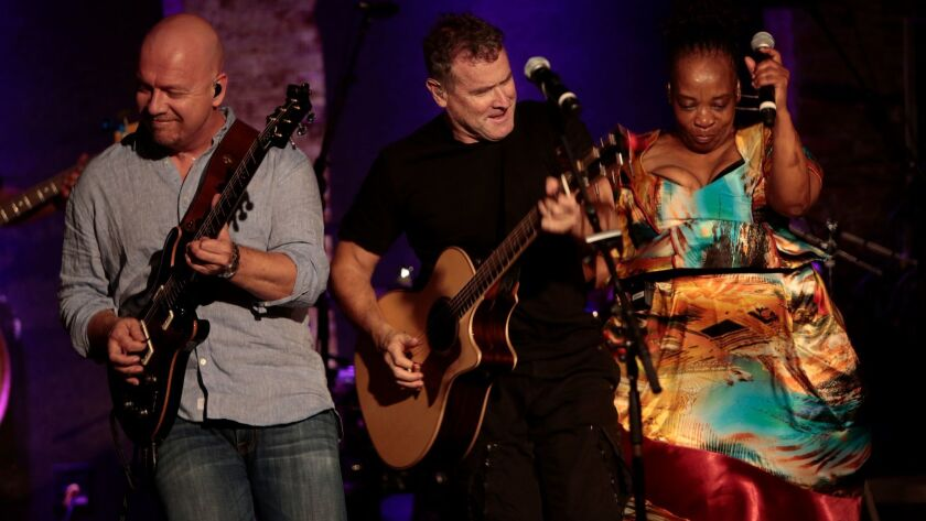 South Africa's Johnny Clegg, center, shown performing in New York in 2014, will return this fall for what he's calling his final performances in North America following a 2015 cancer diagnosis.