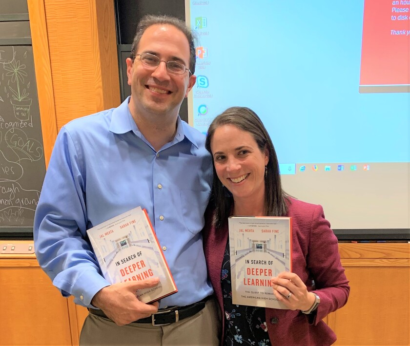 """San Diegan Sarah Fine (right), an instructor at High Tech High's Graduate School of Education, and Jal Mehta, a Harvard University professor, hold their """"In Search of Deeper Learning"""" book that won the duo the $100,000 2020 Grawemeyer Award for Education."""