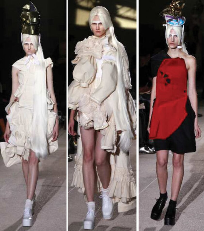 Looks from the Comme des Garcons spring-summer 2013 runway collection shown during Paris Fashion Week.