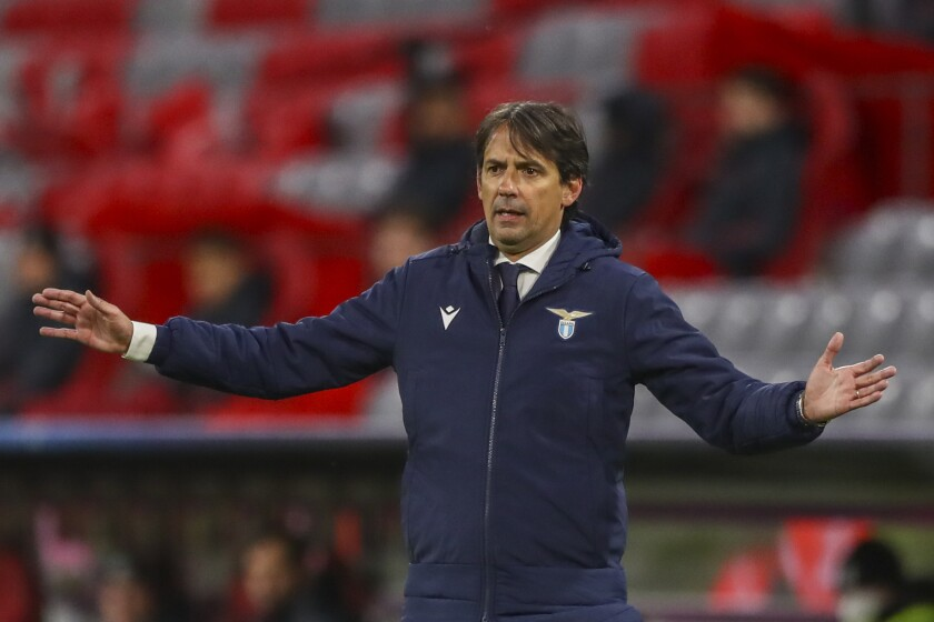 FILE - In this March 17, 2021, Lazio's head coach Simone Inzaghi gives instruction during the Champions League, match between FC Bayern Munich and Lazio at the soccer Arena stadium, Germany. Serie A champion Inter Milan appointed Simone Inzaghi as its new coach on Thursday, June 3, 2021, with the former Lazio manager signing a two-year contract. Inzaghi replaced Antonio Conte, who left the club last month, just weeks after leading the Nerazzurri to their first league title in more than a decade. (AP Photo/Matthias Schrader)