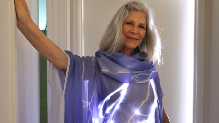 Rachel Merrill wears a dress with lights in it. Her and her son Devon Merrill design clothing with lights.