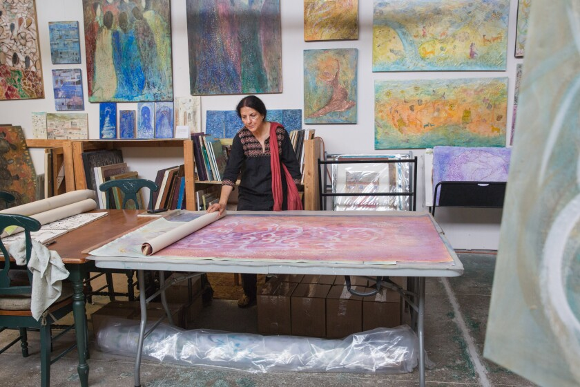 Salma Arastu in her Berkeley studio. The artist has curated two gallery shows centered on Islamic calligraphy.