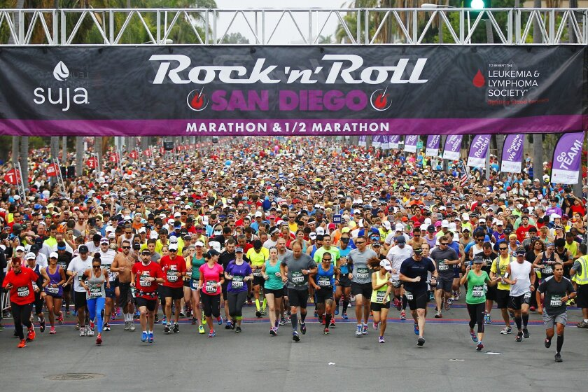 Runners start San Diego Rock 'n' Roll Marathon down 6th Ave. near Balboa Park.