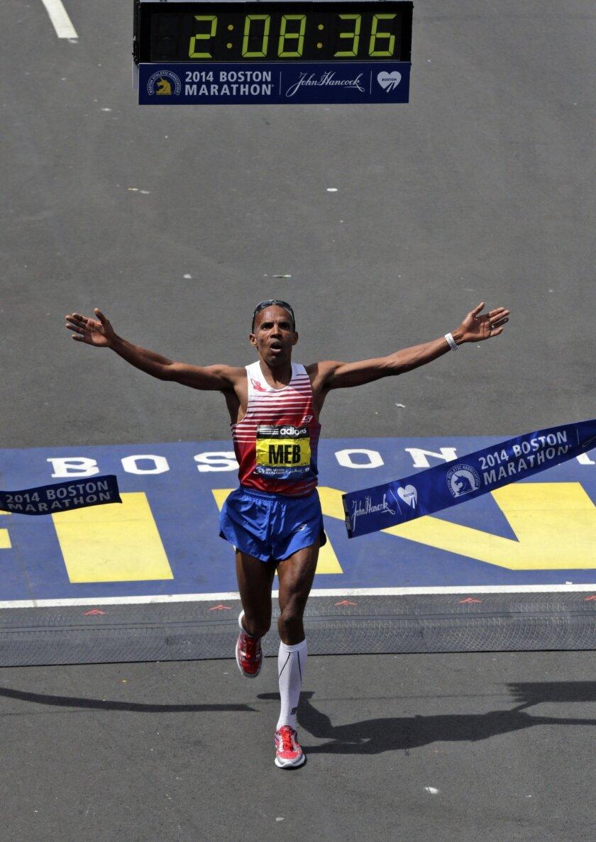 Meb Keflezighi, of San Diego, Calif., breaks the tape to win the 118th Boston Marathon Monday, April 21, 2014 in Boston. (AP Photo/Charles Krupa)