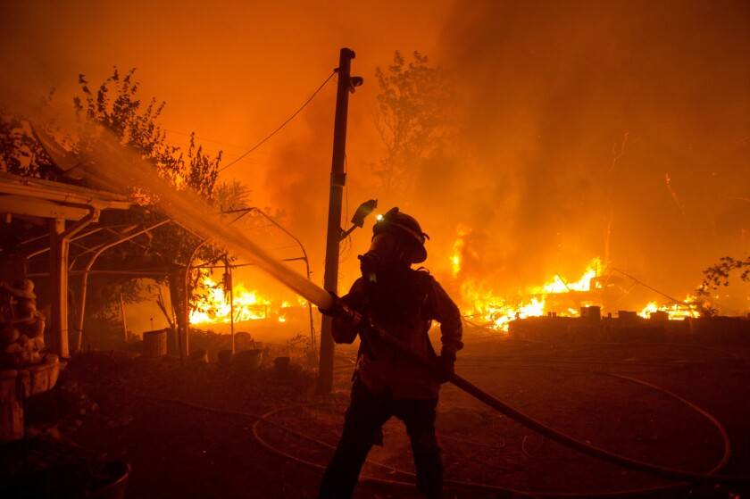 A firefighter works against the Lake Hughes Fire in Angeles National Forest north of Santa Clarita.