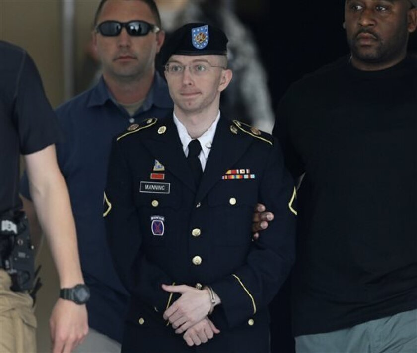 FILE - Army Pfc. Bradley Manning is escorted out of a courthouse in Fort Meade, Md., in a Tuesday, July 30, 2013 file photo, after receiving a verdict in his court martial. Manning's defense team is opening its case at the soldier's sentencing hearing. Defense attorney David Coombs says he expects to call the first of more than a dozen witnesses Monday, Aug. 12, 2013 in the court-martial at Fort Meade, near Baltimore. He says Manning will give a statement before the defense rests on Wednesday. (
