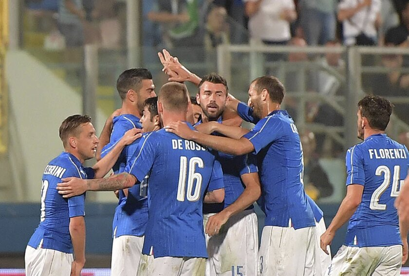 Italy's Graziano Pellè celebrates with teammates after scoring during a friendly match between Italy and Scotland, in preparation for the upcoming Euro 2016 European Championships, at the Ta' Qali stadium in Attard, Malta, Sunday, May 29, 2016. (AP Photo/Rene Rossignaud)