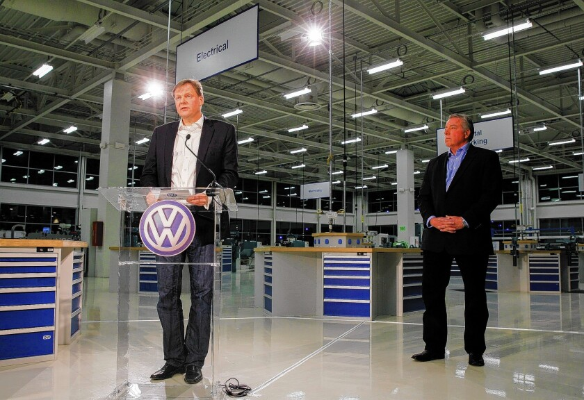 Frank Fischer, chairman and chief executive of the Volkswagen plant in Chattanooga, Tenn., speaks at a news conference Friday after workers rejected a unionization bid. At right is Gary Casteel, a regional director for the United Auto Workers union.