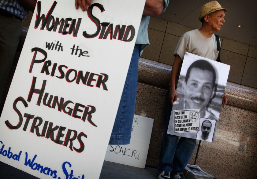 John A. Imani joins about 75 demonstrators Monday in front of the Ronald Reagan State Building in Los Angeles for a rally held in support of Pelican Bay State Prison inmates who are refusing meals in protest of conditions at the prison.