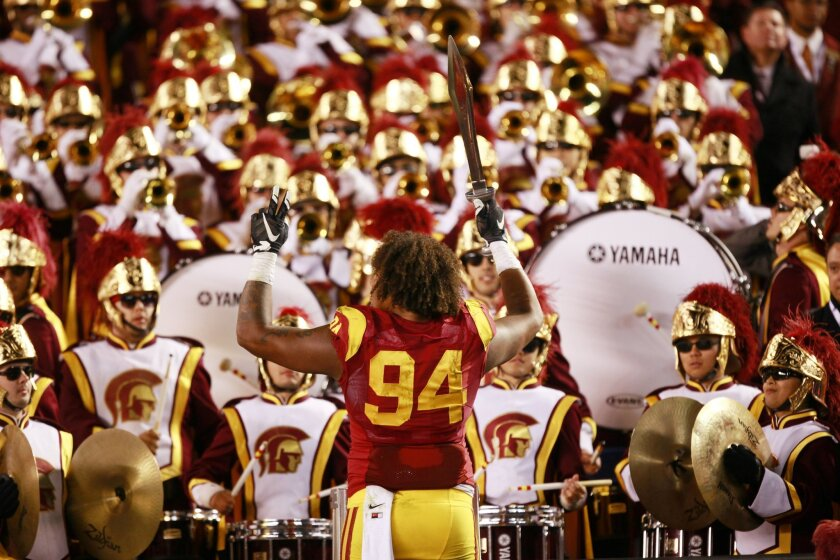 USC's Leonard Williams  leads the Trojan marching band after a victory over Nebraska  in the Holiday Bowl.
