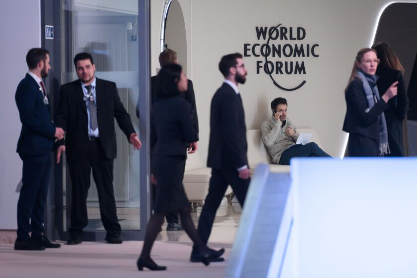 Staff members circulate at the Davos conference center on Monday before the annual meeting of the World Economic Forum.
