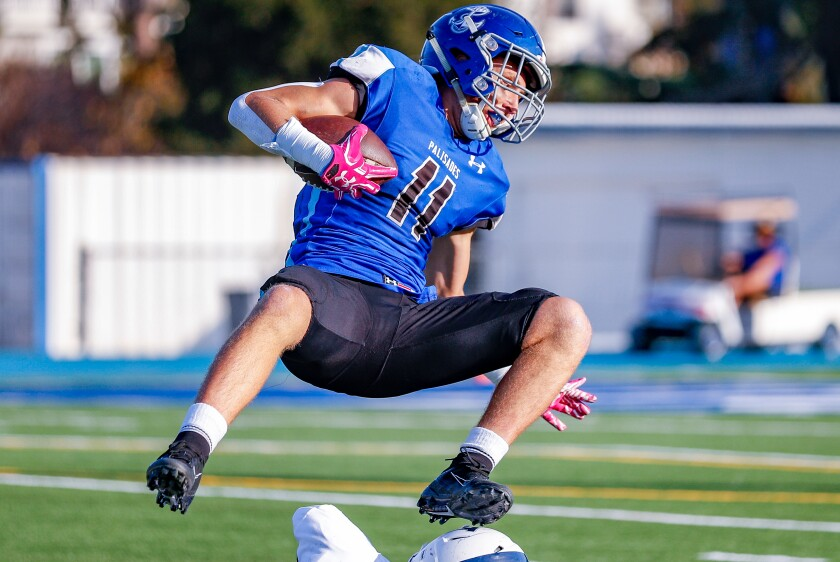 Palisades' Max Palees gets up ended after catching a pass in the first half of Palisades' win over Venice on Oct. 14, 2019.