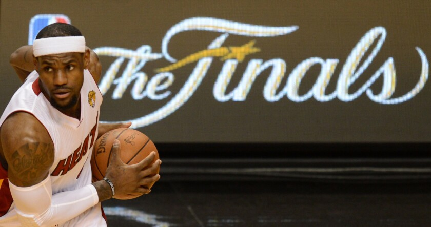 LeBron James helped the Miami Heat win two NBA titles in four Finals appearances.