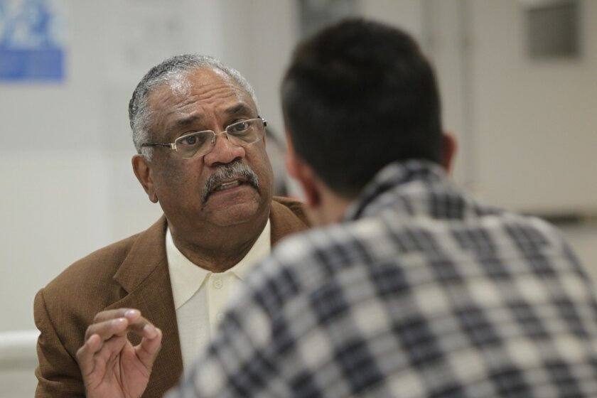 Over lunch at the Rescue Mission, Herb Johnson talks with a homeless client