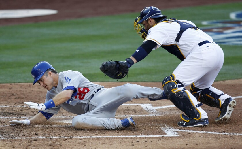 Dodgers infielder Chase Utley is tagged out by Padres catcher Derek Norris while trying to score on a Justin Turner hit in the third inning.