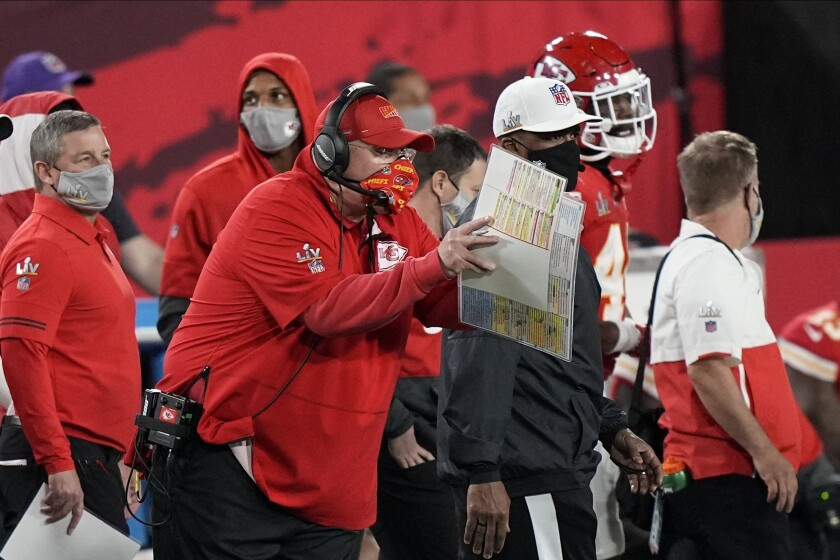Kansas City Chiefs' Andy Reid works during the first half of the NFL Super Bowl 55 football game against the Tampa Bay Buccaneers Sunday, Feb. 7, 2021, in Tampa, Fla. (AP Photo/David J. Phillip)