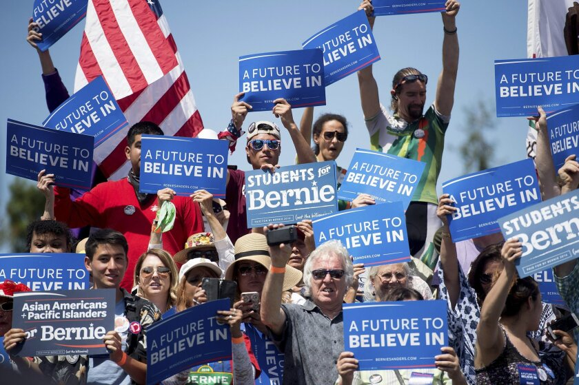 Supporters of Democratic presidential candidate Sen. Bernie Sanders, I-Vt., cheer during a campaign rally at the Cubberley Community Center on Wednesday, June 1, 2016, in Palo Alto, Calif. (AP Photo/Noah Berger)
