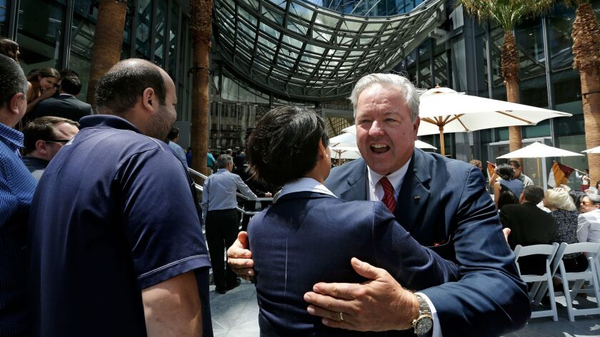 Christopher Martin, right, chairman and chief executive of AC Martin, celebrates with Blanca Diaz, s