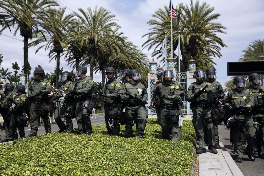 Orange County sheriff's deputies advance to disperse Trump protesters Wednesday in Anaheim. Police will be monitoring demonstrations in San Diego today.