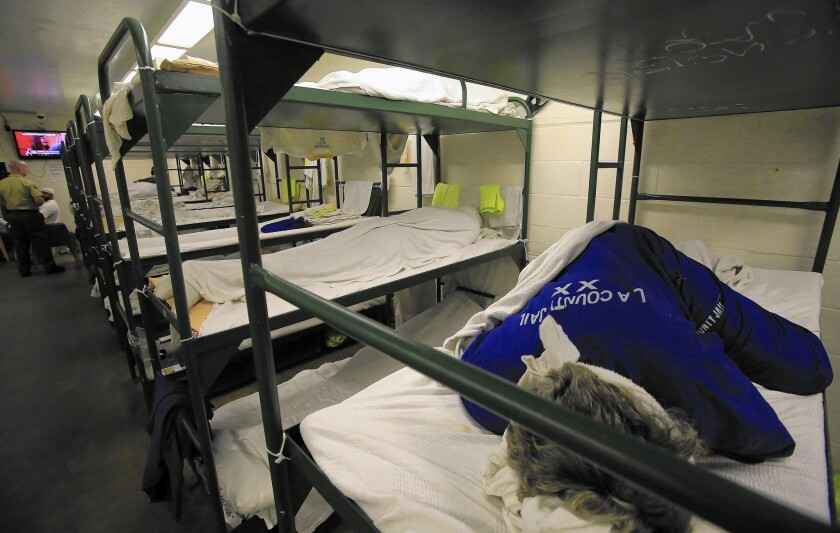 An inmate sleeps in a triple bunk dorm room in the Men's Central Jail. Proposition 47 has reduced jail crowding, curtailing the need for early release programs.