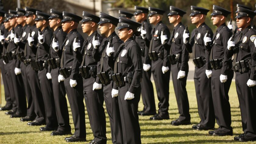 LOS ANGELES, CA – APRIL 13, 2018: New Los Angeles Police Officer Teresa Altamirano, center, durin