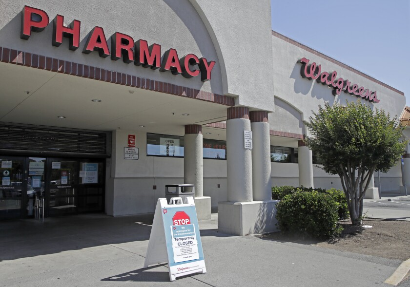Sign alerting customers to a closed Walgreens store