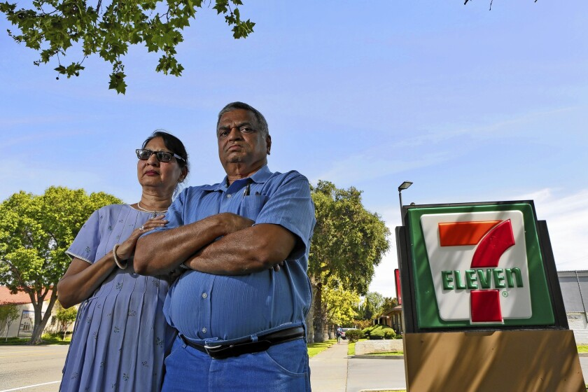 """Saroj Patel, left, and her husband, Dilip, allege 7-Eleven used """"storm trooper interrogation and isolation tactics"""" to strip them of the Riverside store that they had run since 1995."""