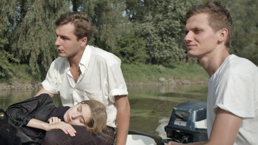 "Eva Lebuef, Michal Huzscza, center, and Krzysztof Baginski in ""All These Sleepless Nights."""