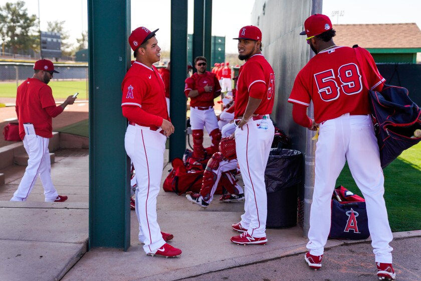 Angels pitchers (from left) Jose Suarez and Jaime Barría chat with outfielder Jo Adell at Tempe Diablo Stadium on Feb. 18.