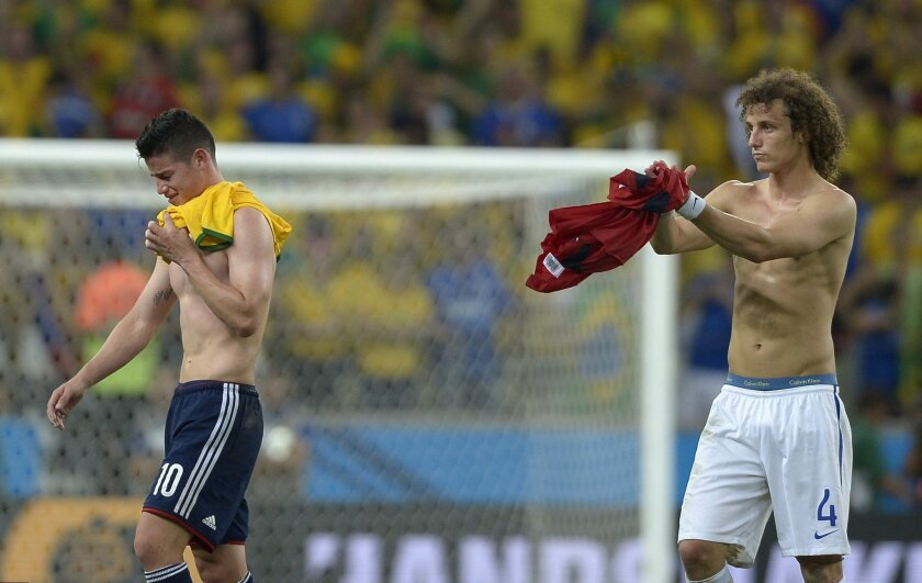 Brazil's David Luiz, right, applauds Colombia's James Rodriguez at the end of the World Cup quarterfinal soccer match between Brazil and Colombia at the Arena Castelao in Fortaleza, Brazil, Friday, July 4, 2014. Brazil won the match 2-1. (AP Photo/Manu Fernandez)