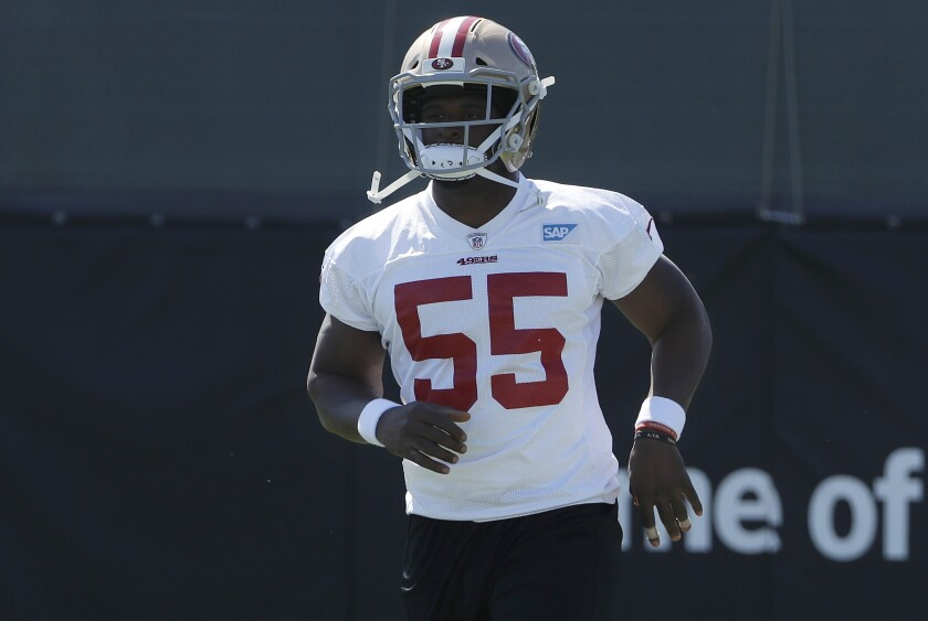 San Francisco 49ers' Dee Ford jogs during a team training camp session on July 27.