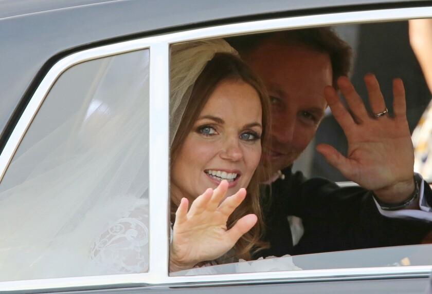 Spice Girl Geri Halliwell and Formula One boss Christian Horner wave after their wedding in Woburn, England.
