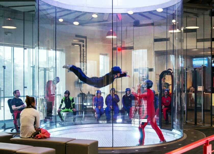 38cbc43ec iFly customers float on a column of air as a trained staff member guides  newcomers how