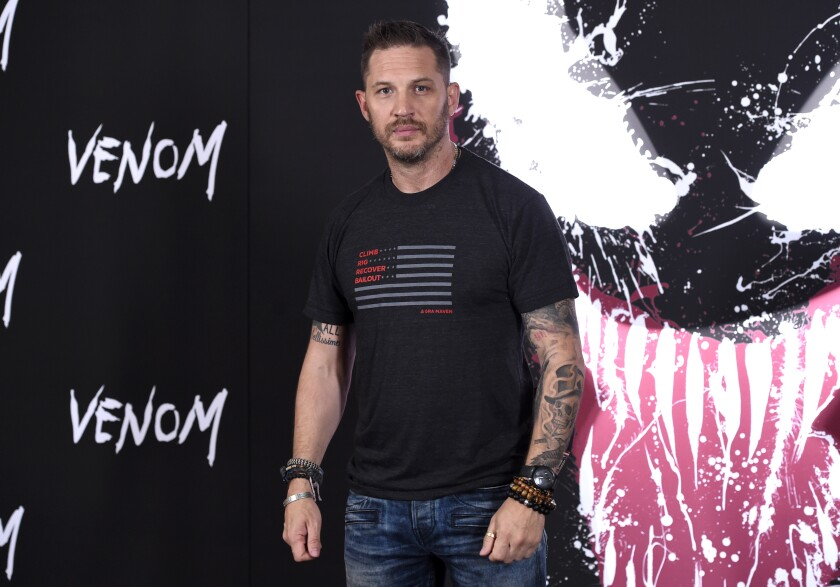 """FILE - Tom Hardy attends a photo call for """"Venom"""" on Sept. 27, 2018, in Los Angeles. In the biggest sign yet that Hollywood's fall plans are being altered by the coronavirus surge driven by the delta variant, Sony Pictures on Thursday, Aug. 12, 2021, delayed the release of the big-budget sequel """"Venom: Let There Be Carnage."""" Instead of opening in theaters Sept. 24, the """"Venom"""" sequel will now debut Oct. 15. The film, starring Hardy, had already been delayed numerous times during earlier stages of the pandemic. (Photo by Chris Pizzello/Invision/AP, File)"""