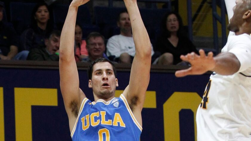 UCLA's Alex Olesinski shoots as California's Marcus Lee defends during the first half on Saturday.